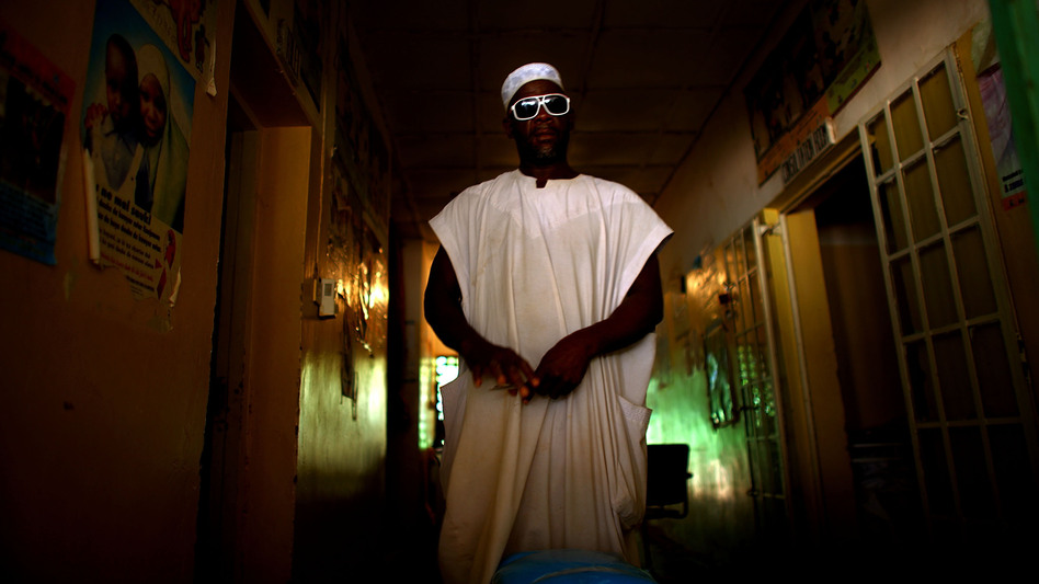 A nurse at the health clinic in Minjibir prepares to distribute free bed nets to combat malaria. Campaigns like this one, which offers services for malaria, attract local residents to the clinic. While they're there, residents are encouraged to get their children vaccinated against polio. (NPR)