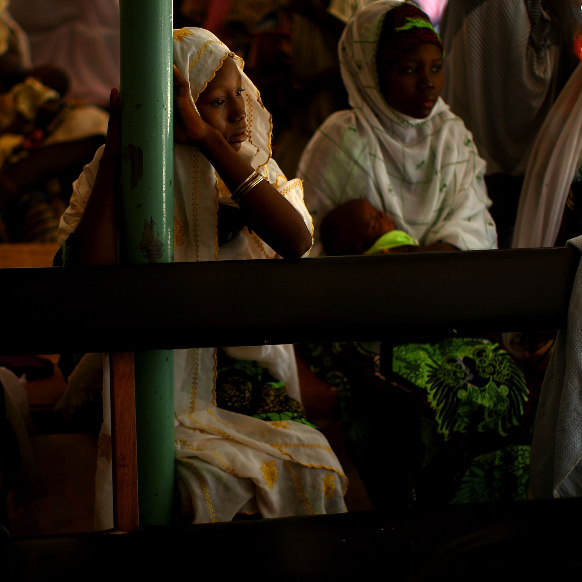 At the health clinic in Minjibir, women wait for their children to receive the polio vaccine.