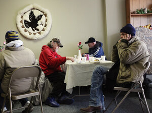 People eat a free community meal at The Center in Lima, Ohio, earlier this year. Although more than 46 million Americans are poor, the issue has gotten little attention in the presidential ra