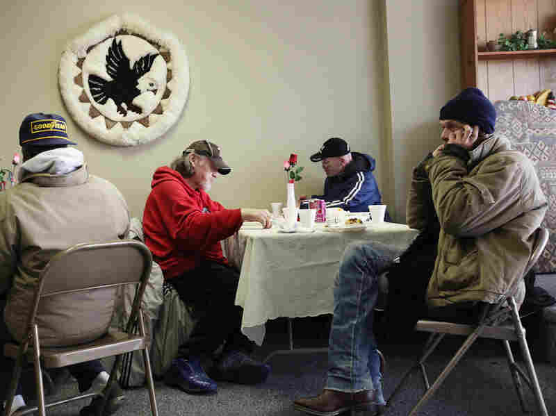 People eat a free community meal at The Center in Lima, Ohio, earlier this year. Although more than 46 million Americans are poor, the issue has gotten little attention in the presidential race.