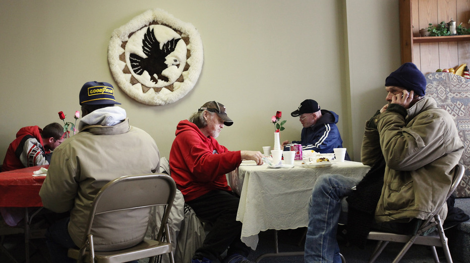 People eat a free community meal at The Center in Lima, Ohio, earlier this year. Although more than 46 million Americans are poor, the issue has gotten little attention in the presidential race. (Getty Images)
