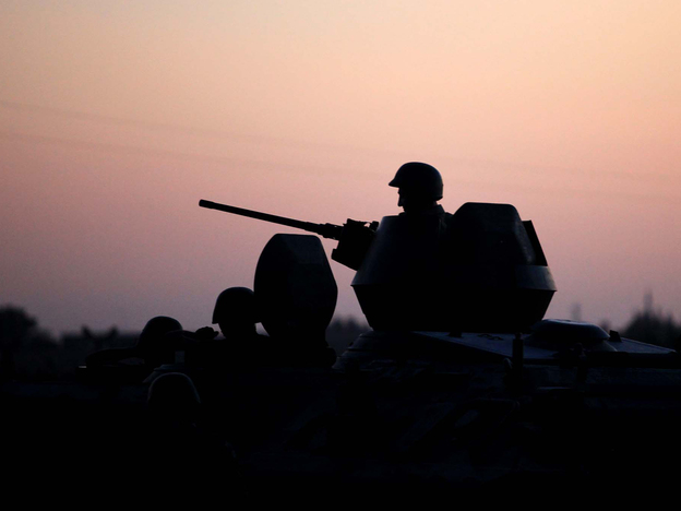 Turkish soldiers stand near the Turkey-Syria border in Akcakale, Turkey, early Friday.