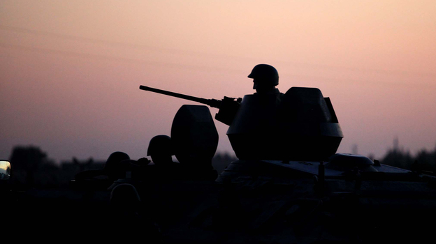 Turkish soldiers stand near the Turkey-Syria border in Akcakale, Turkey, early Friday. (AP)