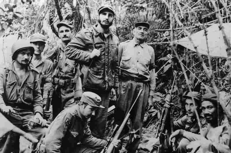 In 1956, Castro returned to Cuba to lead his movement from the Sierra Maestra Mountains. This photo shows the top command of the guerrilla army, including Castro's brother, Raul (kneeling, bottom left) and Che (second from left).