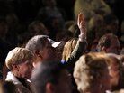 An audience member holds up his hand at a Mitt Romney town hall meeting in Dayton, Ohio, in March. Audience members will be allowed to ask questions at the second presidential debate, being held Tuesday night in Hempstead, N.Y.