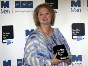 Hilary Mantel, winner of the Man Booker Prize for Fiction, poses with her prize shortly after the award ceremony in London Tuesday. Mantel, won the 50,000 British p