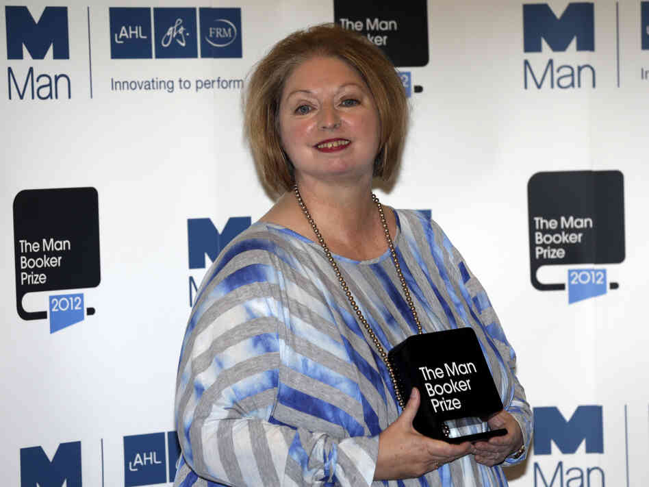 Hilary Mantel, winner of the Man Booker Prize for Fiction, poses with her prize shortly after the award ceremony in London Tuesday. Mantel, won the 50,000 British