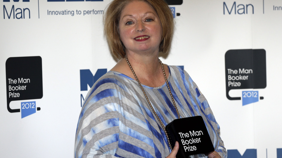Hilary Mantel, winner of the Man Booker Prize for Fiction, poses with her prize shortly after the award ceremony in London Tuesday. Mantel, won the 50,000 British pounds (approximately $80,000) prize with her book Bring up the Bodies. (AP)