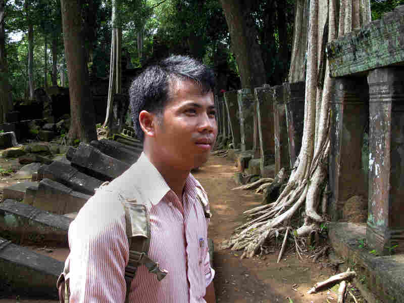 Archaeologist Phin Samnang, 29, surveys the ruins of Prasat Chen temple at Koh Ker. He says that unlike in earlier periods, Cambodia now has the means and duty to reclaim its priceless lost antiquities.