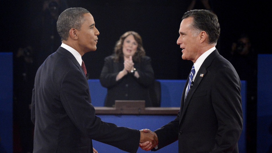 President Obama and Republican nominee Mitt Romney shake hands before their debate Tuesday in Hempstead, N.Y. (Pool/Getty Images)