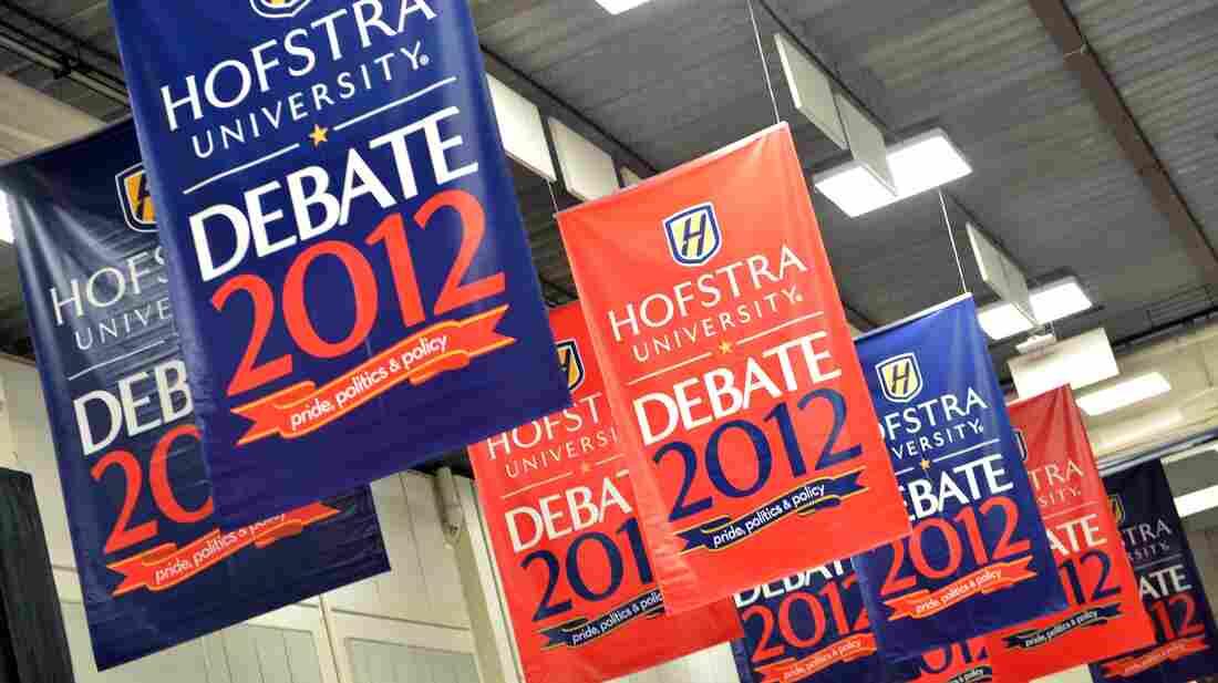 Banners hang inside the media center amid preparations for tonight's presidential debate at Hofstra University in Hempstead, N.Y.