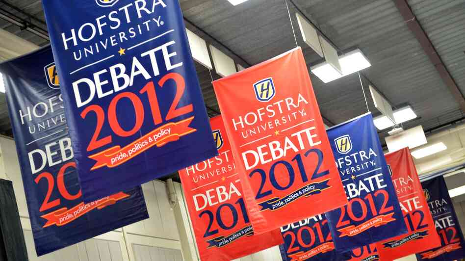 Banners hang inside the media center amid preparations for tonight's presidential debate at Hofstra University in Hempstead, N.Y.