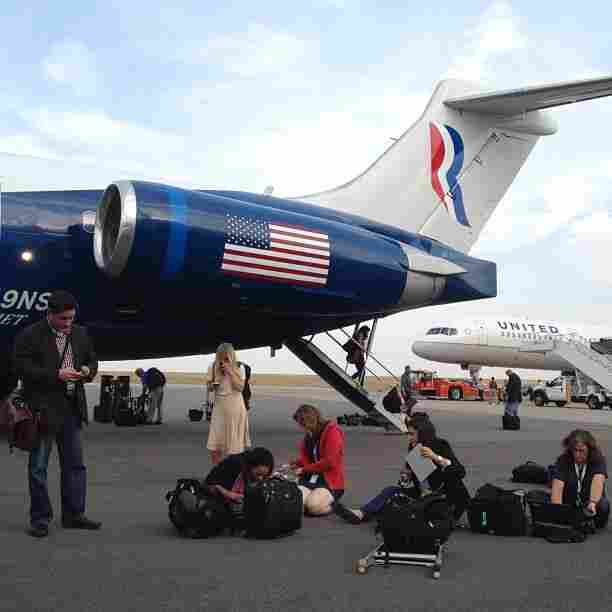Campaign reporters file their stories on the tarmac in Denver after Mitt Romney took questions in flight. @charlesdharapak