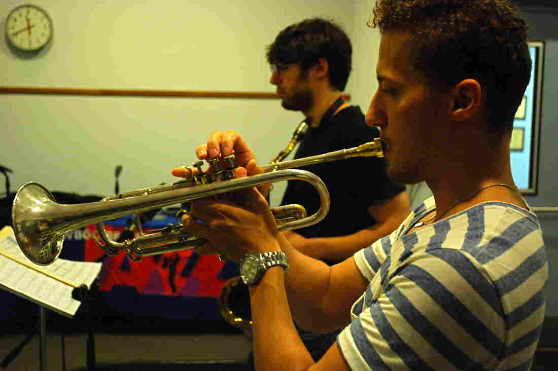 Philip Dizack at WBGO, with saxophonist Jake Saslow in the background.