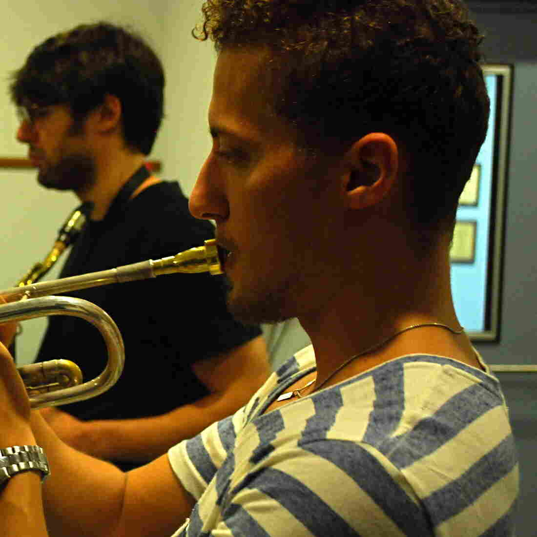 Philip Dizack at WBGO, with saxophonist Jake Saslow in the background.