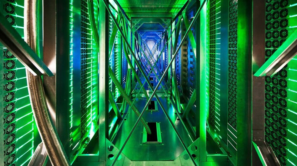 A rare look behind the server aisle in Mayes County, Okla. Hundreds of fans funnel hot air from the server racks into a cooling unit to be recirculated. This is the first time Google has opened the doors of its data centers to outsiders. (Google)