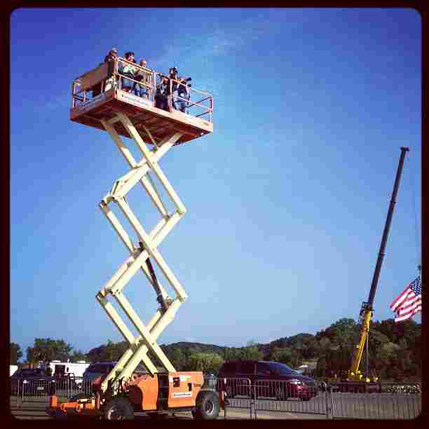 Photogs get a lift at Romney's last stop of the day, in Holland, Mich. @ashleyrparker