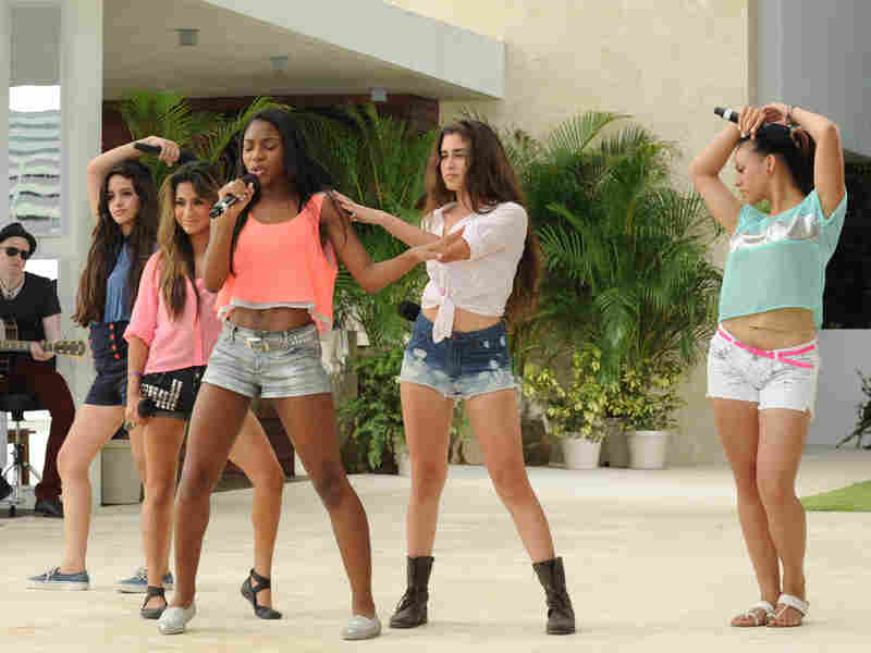 Girl group Lylas performs in front of Simon Cowell and guest mentor Marc Anthony on The X Factor.