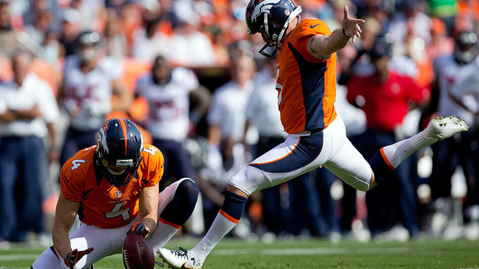 Place kicker Matt Prater of the Denver Broncos kicks a second quarter field goal on a hold by Britton Colquitt against the Houston Texans at Sports Authority Field Field at Mile High in Denver on Sept. 23. (Getty Images)
