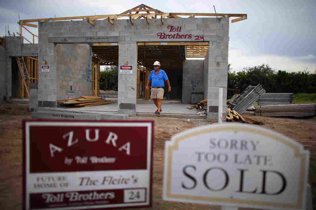 Construction worker Jim Castellano walks out of a Toll Brothers Inc. home he is working on in Boca Raton, Florida.