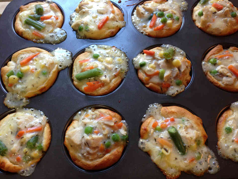 Bubbling chicken potpie cupcakes, fresh out of the oven. Crescent roll dough cre
