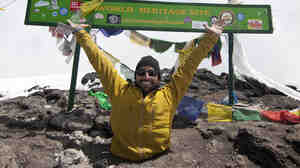 Spencer West at the summit of Mount Kilimanjaro.