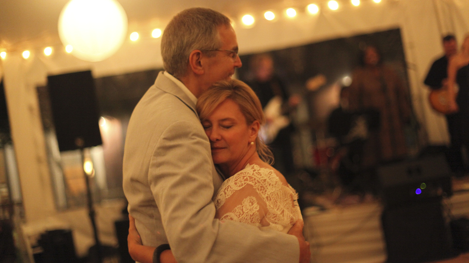 Marcela Gaviria dances with her orthopedic doctor, Dempsey Springfield, at her wedding in June 2012, some 30 years after he performed her first surgery. (Courtesy of Lauren DeCicca)