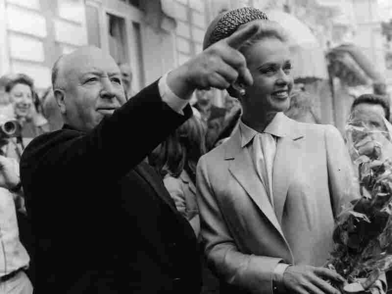 The real Alfred Hitchcock and Tippi Hedren explore Cannes together after the premiere of The Birds in 1963.