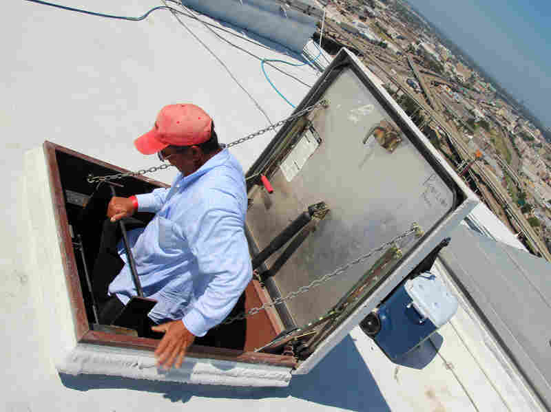 As the roofers get to the top, they literally straddle the void, swinging their bodies from the ladder to the roof over a small but frightening gap.