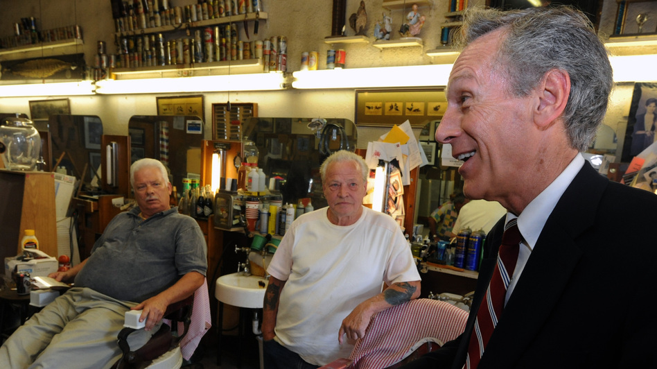 Constitution Party presidential candidate Virgil Goode (right) visits a barber shop while campaigning in Lynchburg, Va., in September.