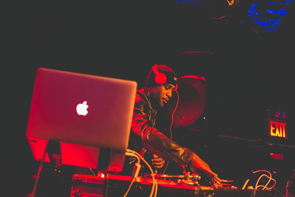 Ali Shaheed Muhammad of A Tribe Called Quest (and NPR Music's hip-hop stream, Microphone Check) DJs between sets at (Le) Poisson Rouge. (Loren Wohl for NPR)