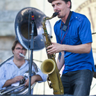 Saxophonist John Ellis (center) performs with Matt Perrine (left) on sousaphone at the 2012 Newport Jazz Festival.