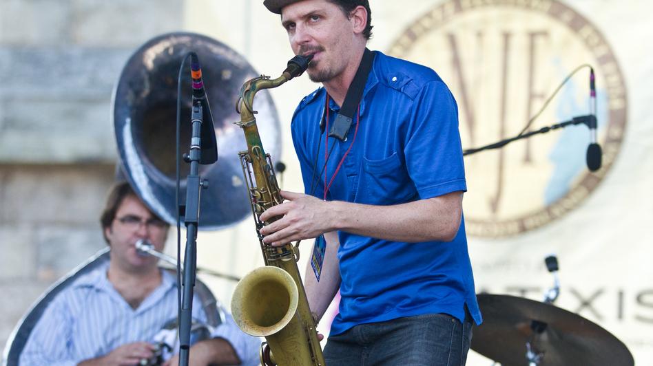 Saxophonist John Ellis (center) performs with Matt Perrine (left) on sousaphone at the 2012 Newport Jazz Festival.