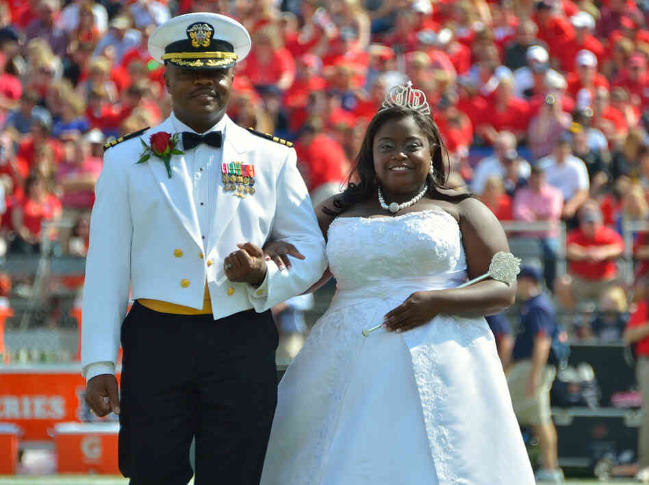 University of Mississippi Homecoming Queen Courtney Pearson, as she was escorted on to the football field last Saturday by her father, Cmdr. Kerry Pearson.
