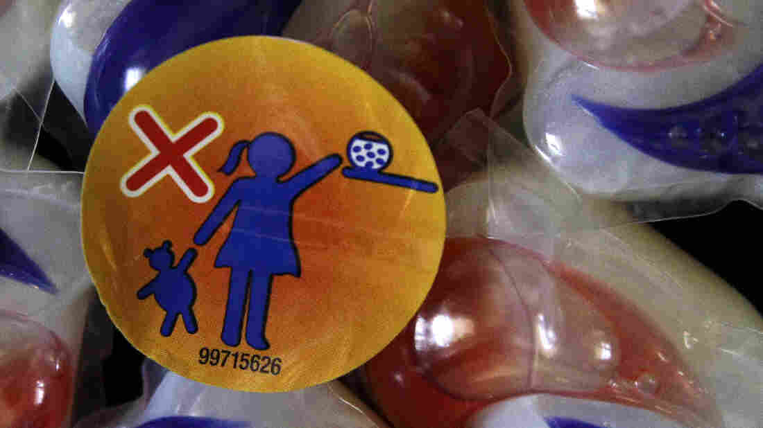 A label warns parents to keep Tide laundry detergent packe