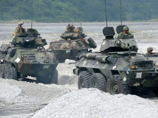 U.S. Marines drive amphibious armored personnel carriers in the Philippines on Oct. 9, as part of the annual joint exercises with Philippine counterparts.