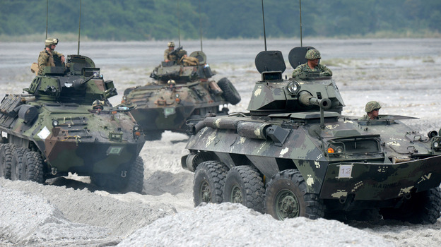 U.S. Marines drive amphibious armored personnel carriers in the Philippines on Oct. 9, as part of the annual joint exercises with Philippine counterparts. (AFP/Getty Images)