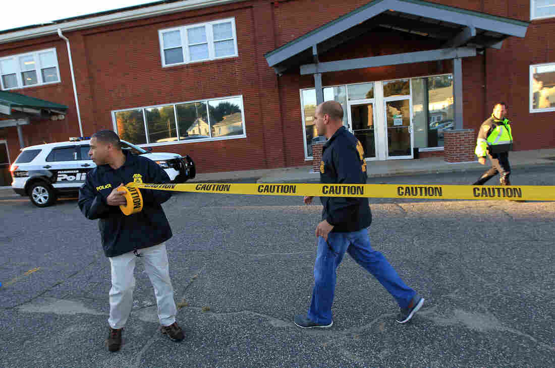Federal agents investigate the offices of the New England Compounding Center in Framingham, Mass., on Tuesday. The company's steroid medication has been linked to a deadly meningitis outbreak.