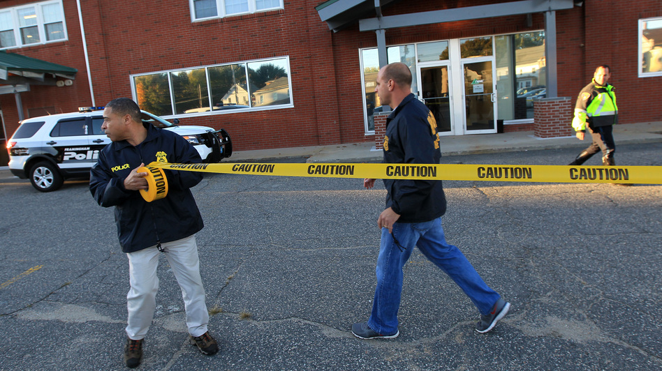 Federal agents investigate the offices of the New England Compounding Center in Framingham, Mass., on Tuesday. The company's steroid medication has been linked to a deadly meningitis outbreak. (AP)