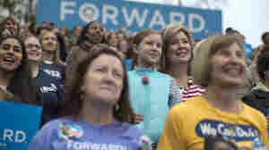 Onlookers listen as President Obama speaks Friday in Fairfax, Va., about the choice facing women in the election.