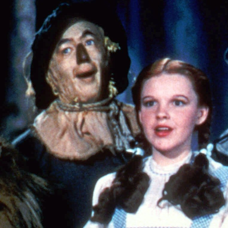 Bert Lahr as the Cowardly Lion, Ray Bolger as the Scarecrow, Judy Garland as Dorothy, and Jack Haley as the Tin Man in The Wizard Of Oz.