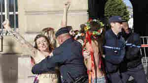 With Topless Protests, 'Sextremists' March In Paris