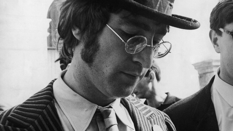 John Lennon signs autographs during the filming of The Magical Mystery Tour. (Hulton Archive/Getty Images)