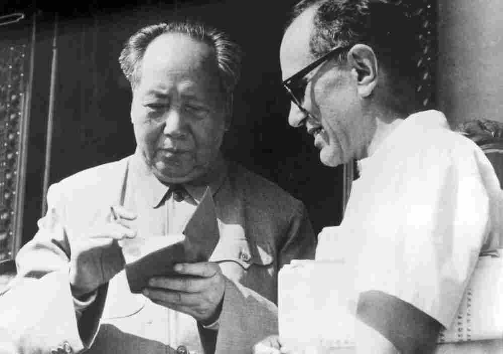 Mao Zedong signs Sidney Rittenberg's copy of The Little Red Book during a gathering of party leaders in Beijing on May 1, 1967, at the beginning of China's Cultural Revolution.