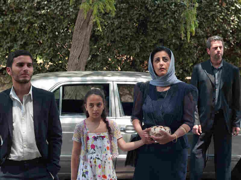 The Al Bezaaz family visits their son's birth family with some hesitation.