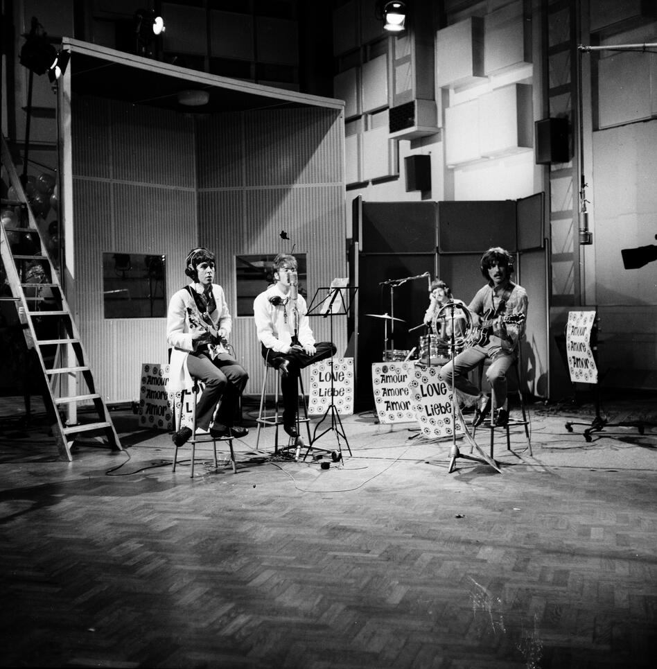 The Beatles rehearse in Studio 1 ahead of the Our World broadcast (1967), the first international satellite television production. This ambitious project showcased creative artists from 19 countries and was viewed by close to 400 million people around the globe — the largest ever TV audience at the time. (Bloomsbury Publishing)