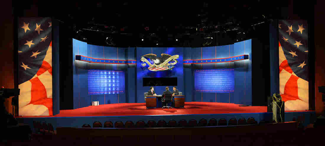 Stand-ins for President Obama, Republican presidential candidate Mitt Romney and moderator Bob Scheiffer rehearse a day ahead of the final presidential debate at Lynn University in Boca Raton, Fla, on Sunday.