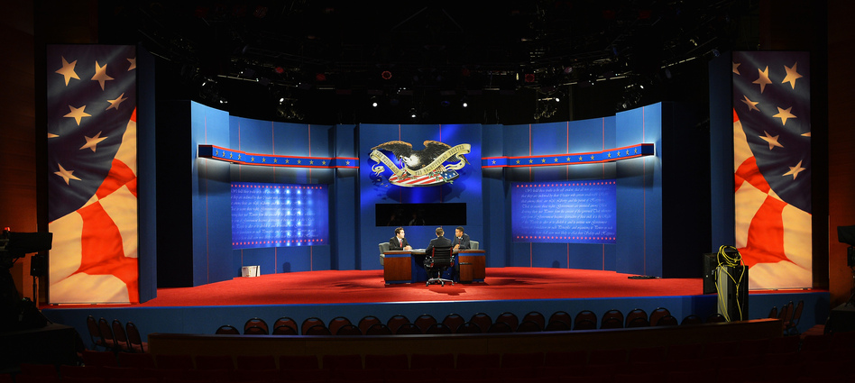 Stand-ins for President Obama, Republican presidential candidate Mitt Romney and moderator Bob Scheiffer rehearse a day ahead of the final presidential debate at Lynn University in Boca Raton, Fla, on Sunday. (AFP/Getty Images)