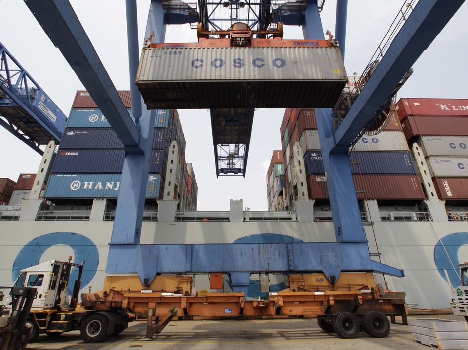 A container ship from China is offloaded at Massport's Conley Terminal in the port of Boston in July. Trade issues with China has been a major talking point for the presidential candidates.