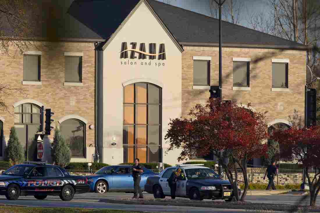 Police personnel work outside the Azana Salon and Spa where three people were killed and four others wounded after a mass shooting on Sunday in Brookfield, Wisconsin.